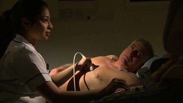 Senior male patient man undergoing echocardiography scan. Echocardiography is a procedure in which the health of the heart is checked using ultrasound. Royalty-free stock video