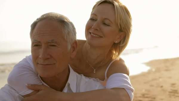 senior couple sitting together on beach Royalty-free stock video