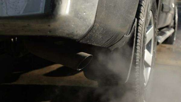Smoke billows from tail pipe, pollution concept Royalty-free stock video