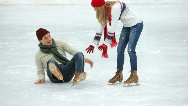 Couple ice skating together in winter Royalty-free stock video