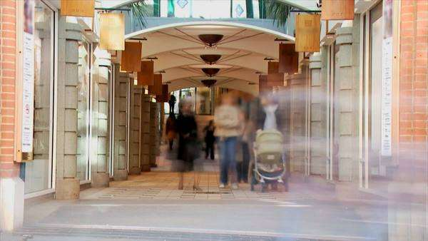 Sshoppers and pedestrians visiting a shopping mall Royalty-free stock video