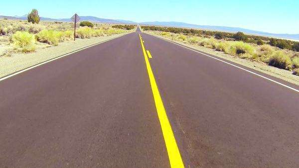 POV shot driving along a desert road at a fast speed. Royalty-free stock video