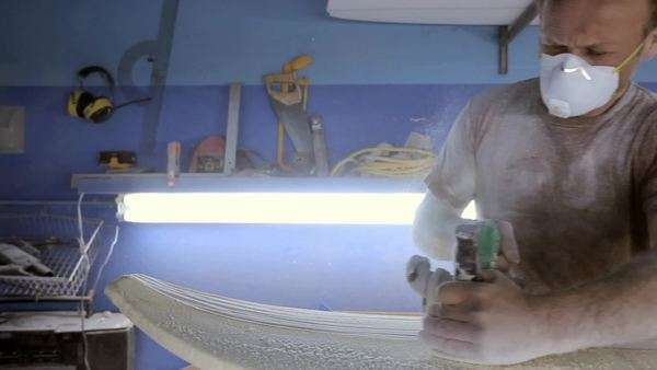 Man sanding new surfboard Royalty-free stock video
