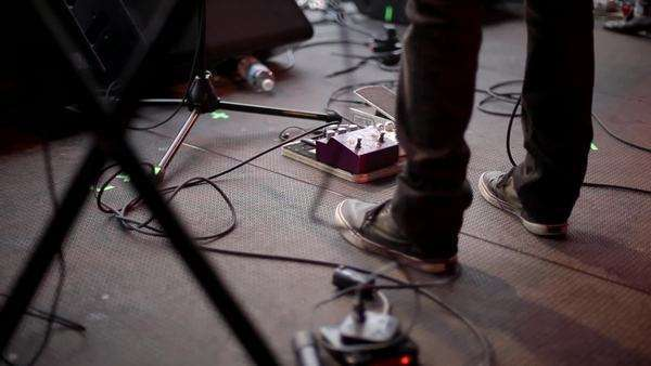 Low shot of a musician's foot as he operates his effects pedal Royalty-free stock video