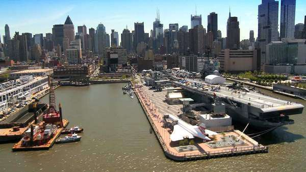 Aerial view of the Intrepid Museum New York with Concorde, USS Intrepid and next year Space Shuttle Enterprise will be displayed on the Dockside in New York Harbor, North America, USA Royalty-free stock video