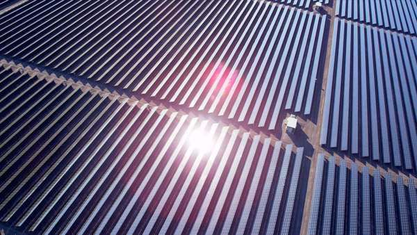 Aerial view large industrial Solar Energy Farm producing concentrated solar energy, USA, RED EPIC Royalty-free stock video