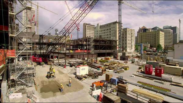 Wide pan of a construction site in downtown Salt Lake City, UT Royalty-free stock video