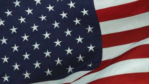 Still close up of the American flag blowing in the wind. Shot in studio. Royalty-free stock video