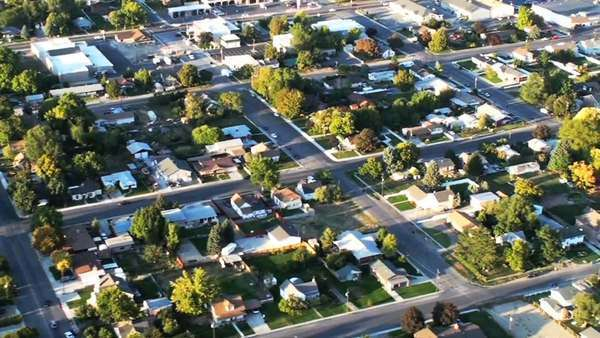 Aerial shot of neighborhood in Utah. Streets, homes and yards are visible. Filmed during the day. Royalty-free stock video