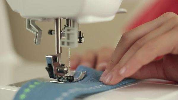 Close-up of mixed race girl using sewing machine Royalty-free stock video