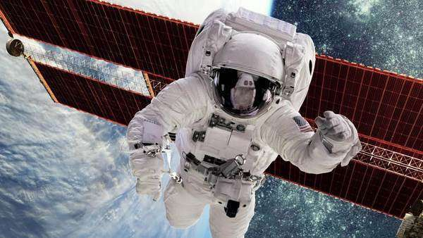 Astronaut in outer space against the backdrop of the planet earth. Elements of this image furnished by NASA. Royalty-free stock video