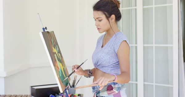 Attractive Woman Artist Painting On Her Patio Standing Working On D1013 133 070