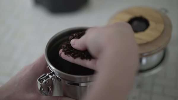 Close-up shot of hands touching ground coffee Royalty-free stock video