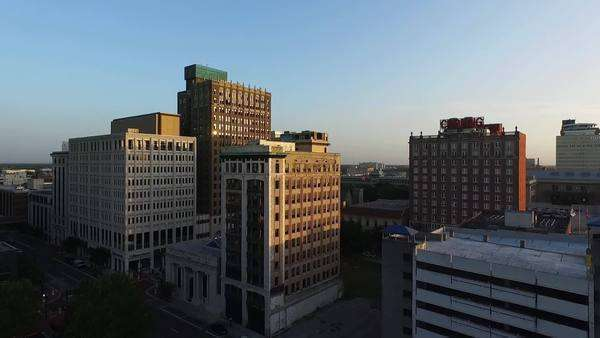 Sunrise aerial shot of downtown buildings Royalty-free stock video
