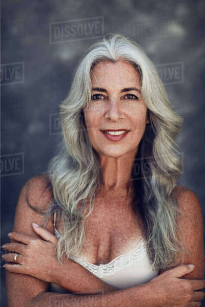 Portrait of happy mature woman with long gray hair