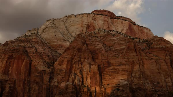 The sun's light rolls over a mountain in Zion at sunset. Royalty-free stock video