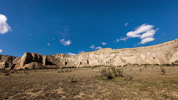 Clouds roll over the Kodachrome Cliffs in the harsh midday sunshine. Royalty-free stock video