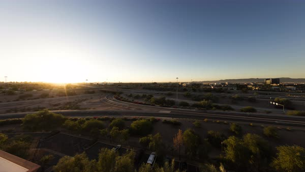 Timelapse of a highway as the sun rises over Phoenix. Royalty-free stock video