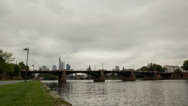 Clouds move over the Frankfurt skyline as seen from the riverside. Royalty-free stock video