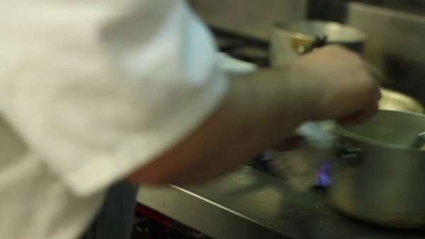 Close-up shot of a chef preparing food in a kitchen Royalty-free stock video