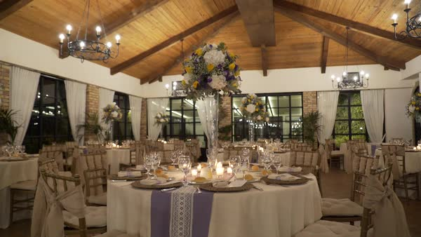 Panning Shot Of Restaurant Interior Set Up For Wedding Reception
