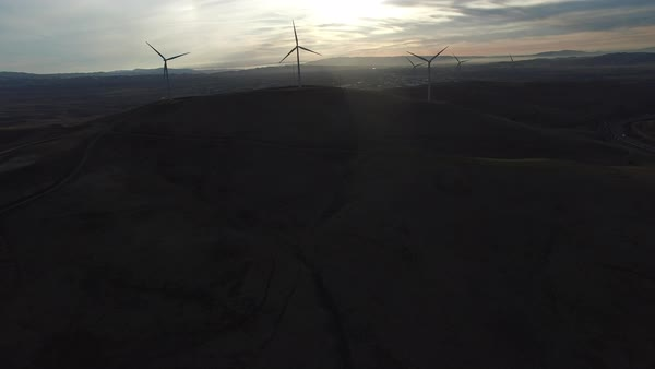 Wide shot of wind turbines at sunset Royalty-free stock video