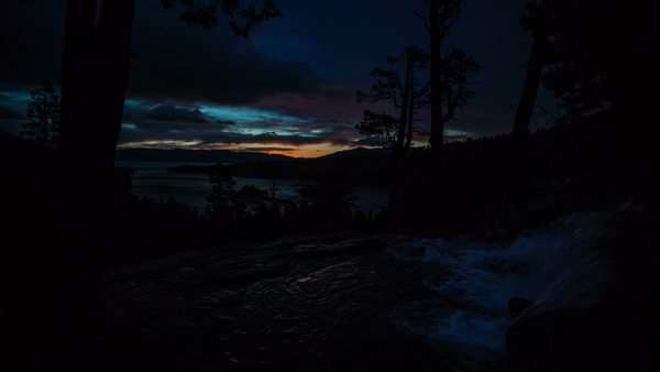 Timelapse at Eagle Falls over looking Lake Tahoe at sunrise, as the clouds light up and snow blows in. Royalty-free stock video