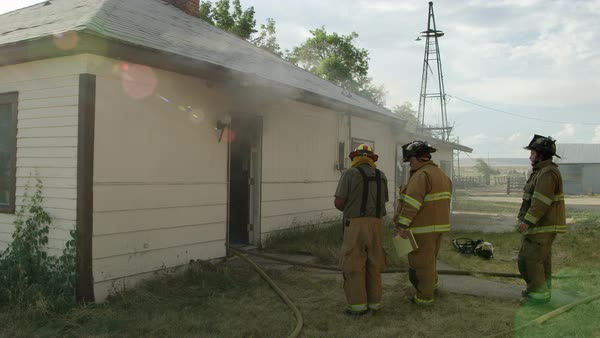 Firemen standing by smoking house during training exercise Royalty-free stock video