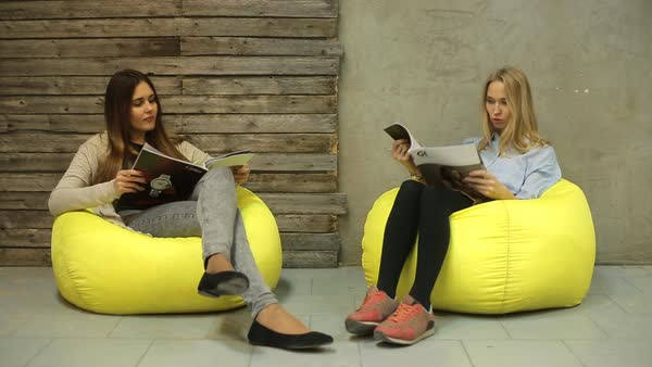 Incredible Two Women Sitting In Beanbag Chairs And Reading Magazines D1104 4 081 Bralicious Painted Fabric Chair Ideas Braliciousco