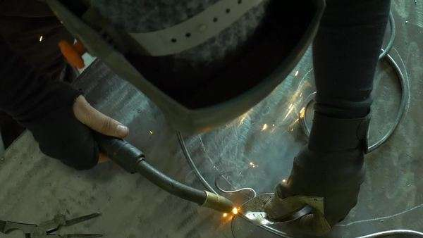 Close-up shot of a blacksmith welding wrought iron Royalty-free stock video