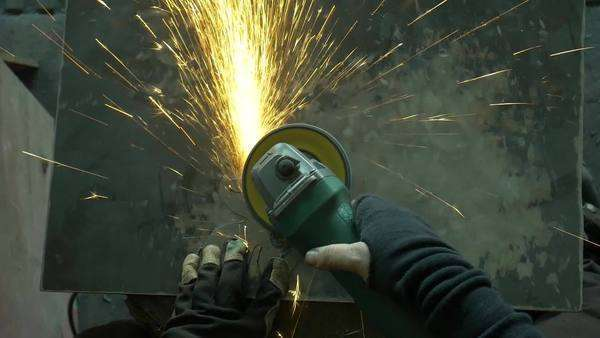 Close-up shot of a blacksmith polishing iron with an angle grinder Royalty-free stock video