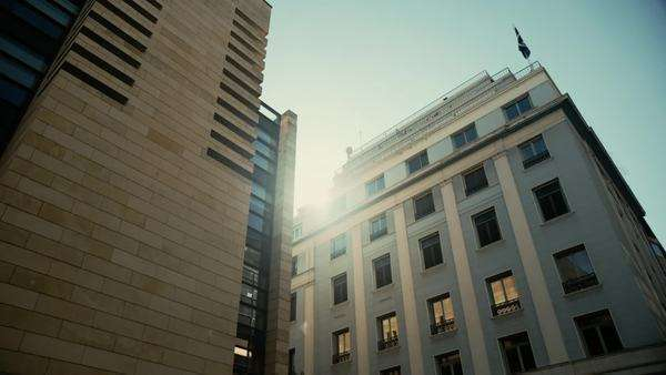 Modern business buildings in the city back light against the sun. Royalty-free stock video