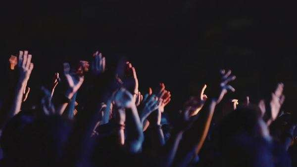 Outdoors night rock concert party people crowd fans cheering applauding hands in the air Royalty-free stock video