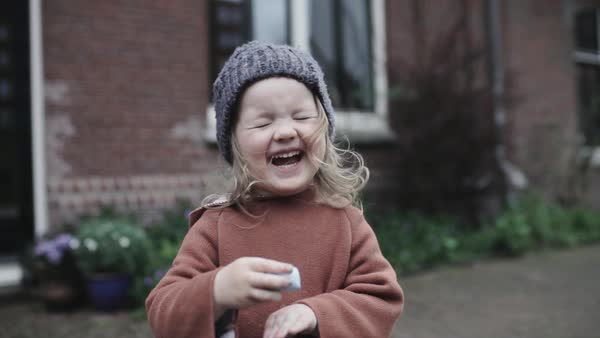 Medium shot of a laughing little girl Royalty-free stock video