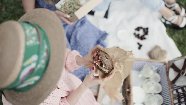 High angle shot of a woman eating a sandwich Royalty-free stock video