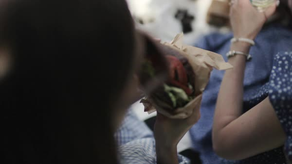 Medium close-up shot of a woman eating a sandwich Royalty-free stock video