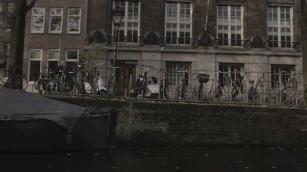 Gimbal shot of a street in Amsterdam from a boat Royalty-free stock video