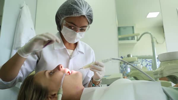 Dentist Close Up Female Examining Teeth Woman Working On PatientaEURTMs Toothache And Dental Care Hygiene Doctor