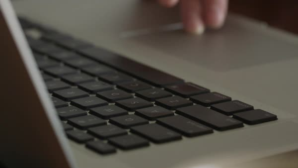 Close up shot of a person using a laptop Royalty-free stock video