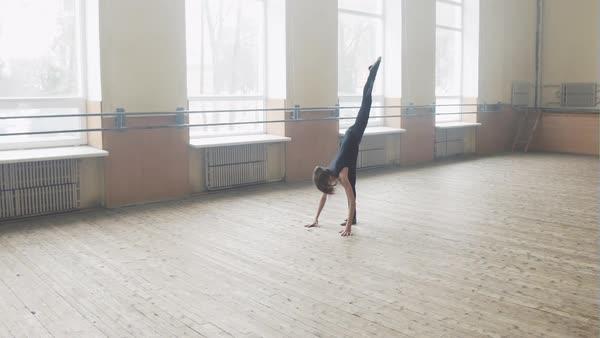 Ballet dancer girl doing splits and dance routine stock footage