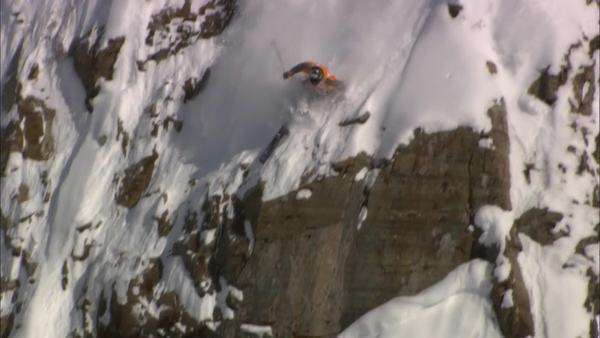 Tracking shot of a skier crushing down a mountain Rights-managed stock video