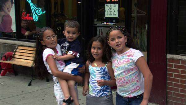 Static shot of four children standing on a street Rights-managed stock video