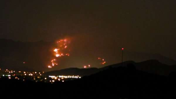 Timelapse of a wildfire on a hillside Rights-managed stock video