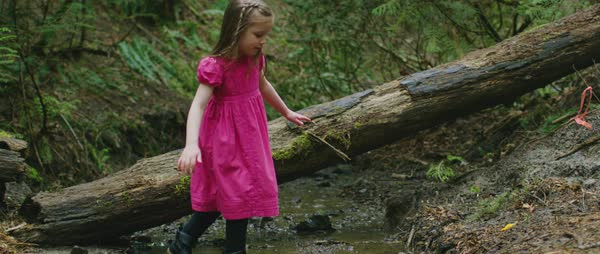 Slow motion shot of a small girl crossing the water stream  Royalty-free stock video