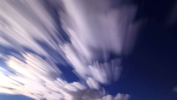 Timelapse of blurred clouds moving through a blue sky Royalty-free stock video