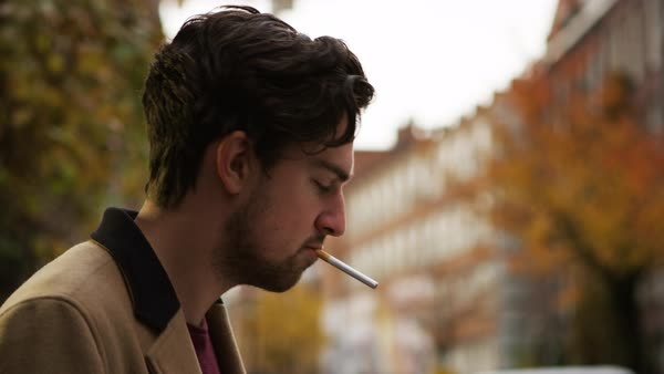 Slow motion of a man putting a cigarette in his mouth Royalty-free stock video
