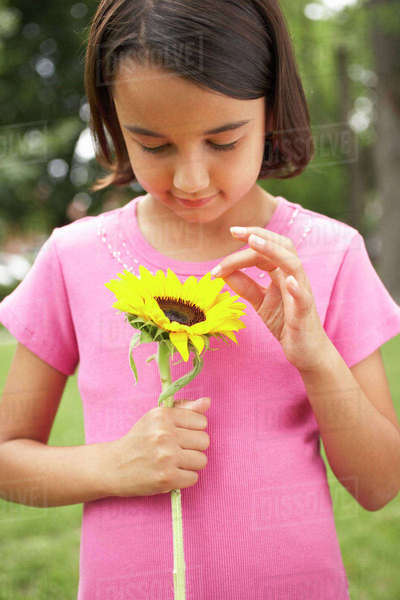 Young Girl Holding Flower Stock Photo - Download Image Now