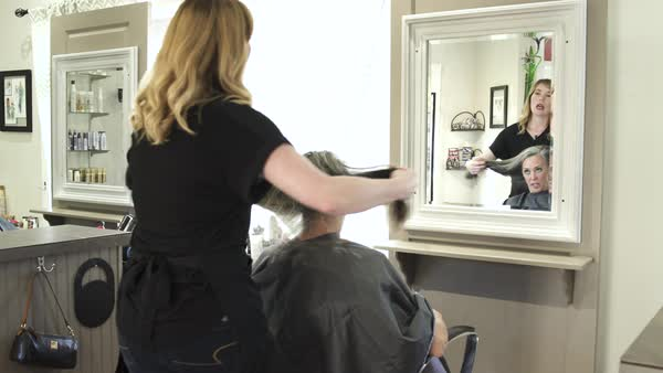 Push-out shot of hairdressers at work Royalty-free stock video