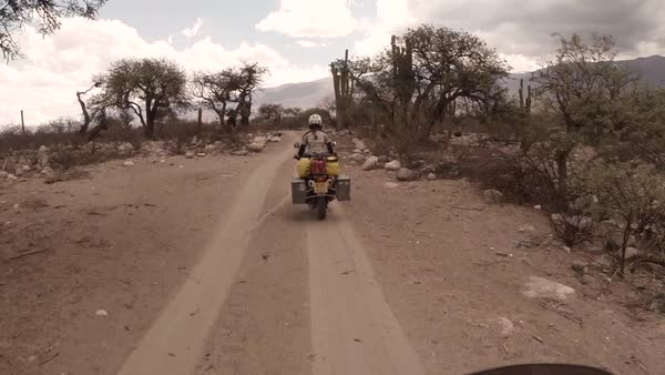 Point of view shot of bikers driving on a dirt road Royalty-free stock video