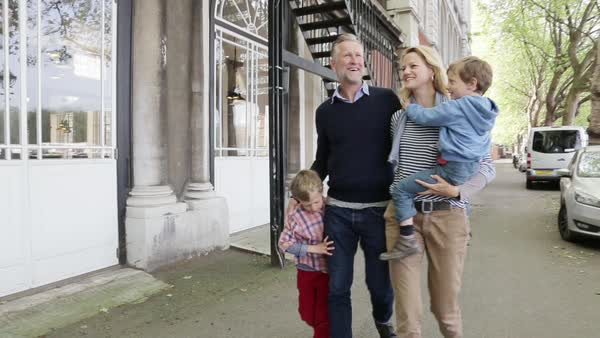Parents with their sons walking along the Thames Royalty-free stock video